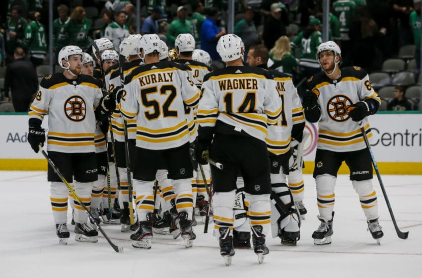 DALLAS, TX - OCTOBER 03: The Boston Bruins celebrate a victory after winning the game between the Dallas Stars and the Boston Bruins on October 03, 2019 at American Airlines Center in Dallas, Texas. (Photo by Matthew Pearce/Icon Sportswire via Getty Images)