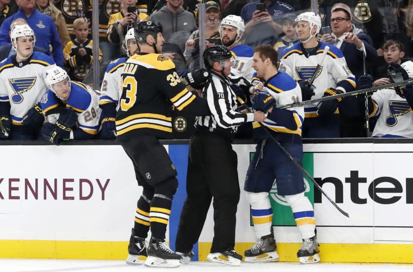 BOSTON, MA - OCTOBER 26: Boston Bruins left defenseman Zdeno Chara (33) and St. Louis Blues center Brayden Schenn (10) are separated by linesman Derek Nansen (70) during a game between the Boston Bruins and the St. Louis Blues on October 26, 2019, at TD Garden in Boston, Massachusetts. (Photo by Fred Kfoury III/Icon Sportswire via Getty Images)