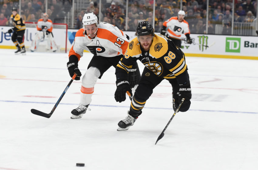 BOSTON, MA - NOVEMBER 10: David Pastrnak #88 of the Boston Bruins skates after the puck against Kevin Hayes #13 of the Philadelphia Flyers at the TD Garden on November 10, 2019 in Boston, Massachusetts. (Photo by Steve Babineau/NHLI via Getty Images)