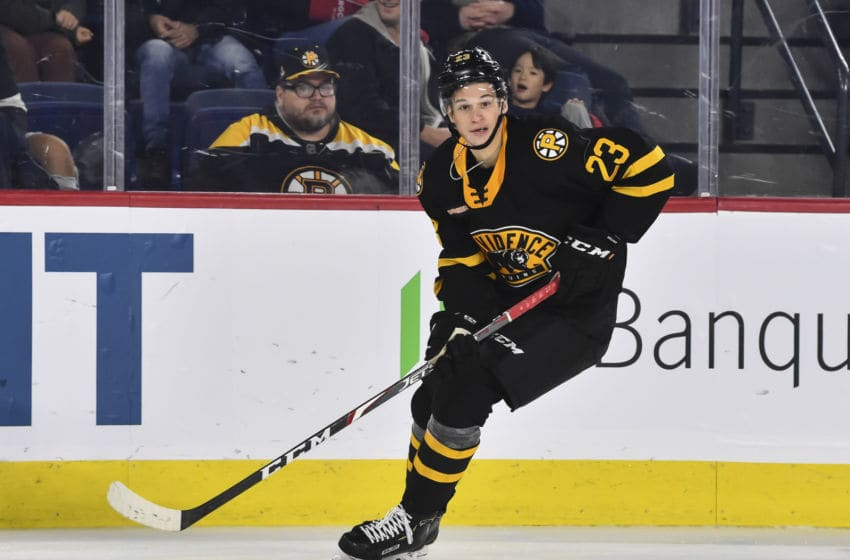 LAVAL, QC - OCTOBER 16: Jack Studnicka #23 of the Providence Bruins skates the puck against the Laval Rocket at Place Bell on October 16, 2019 in Laval, Canada. The Laval Rocket defeated the Providence Bruins 5-4 in a shoot-out. (Photo by Minas Panagiotakis/Getty Images)