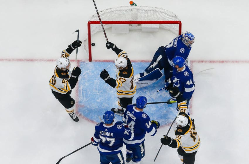 TAMPA, FL - DECEMBER 12: Goalie Andrei Vasilevskiy #88 of the Tampa Bay Lightning gives up a goal against John Moore #27 of the Boston Bruins during the third period at Amalie Arena on December 12, 2019 in Tampa, Florida. (Photo by Scott Audette/NHLI via Getty Images)