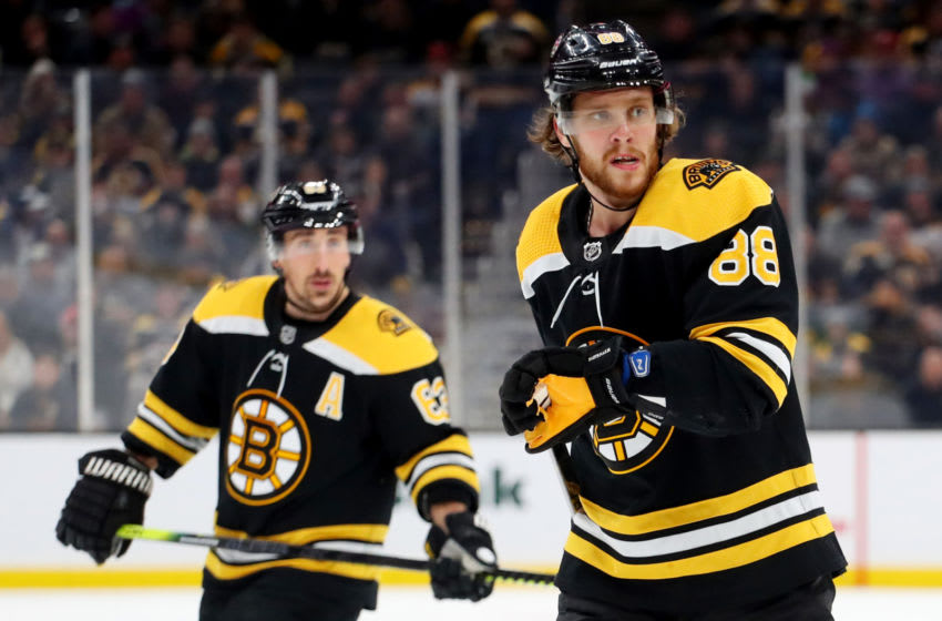 BOSTON, MASSACHUSETTS - DECEMBER 07: David Pastrnak #88 of the Boston Bruins and Brad Marchand #63 skate against the Colorado Avalanche during the third period at TD Garden on December 07, 2019 in Boston, Massachusetts. The Avalanche defeat the Bruins 4-1. (Photo by Maddie Meyer/Getty Images)