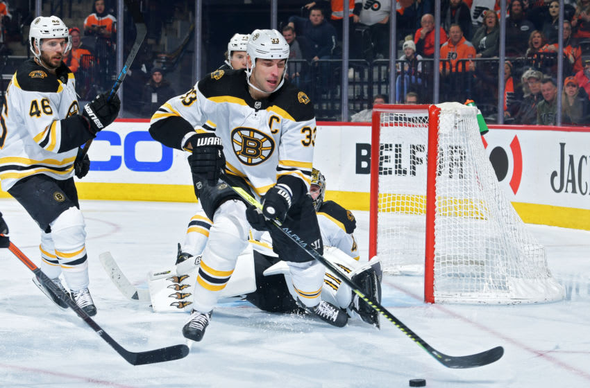 PHILADELPHIA, PA - JANUARY 13: Zdeno Chara #33 of the Boston Bruins, who is playing in his 1000th game, tries to clear the puck during the game against the Philadelphia Flyers in the third period at Wells Fargo Center on January 13, 2020 in Philadelphia, Pennsylvania. The Flyers won 6-5 in a shootout. (Photo by Drew Hallowell/Getty Images)