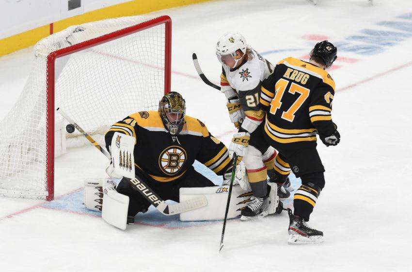BOSTON, MA - JANUARY 21: Jaroslav Halak #41 of the Boston Bruins deflects the puck against the Vegas Golden Knights the TD Garden on January 21, 2020 in Boston, Massachusetts. (Photo by Steve Babineau/NHLI via Getty Images)