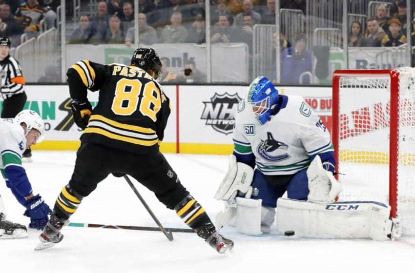 BOSTON, MA - FEBRUARY 04: Vancouver Canucks goalie Jacob Markstrom (25) makes a left pad save on Boston Bruins right wing David Pastrnak (88) during a game between the Boston Bruins and the Vancouver Canucks on February 4, 2020, at TD Garden in Boston, Massachusetts. (Photo by Fred Kfoury III/Icon Sportswire via Getty Images)