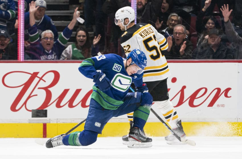 VANCOUVER, BC - FEBRUARY 22: Bo Horvat #53 of the Vancouver Canucks celebrates after scoring a goal as Sean Kuraly #52 of the Boston Bruins skates past during NHL action at Rogers Arena on February 22, 2020 in Vancouver, Canada. (Photo by Rich Lam/Getty Images)