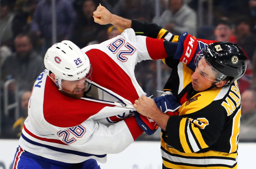 BOSTON, MASSACHUSETTS - FEBRUARY 12: Brad Marchand #63 of the Boston Bruins fights Jeff Petry #26 of the Montreal Canadiens during the first period at TD Garden on February 12, 2020 in Boston, Massachusetts. (Photo by Maddie Meyer/Getty Images)