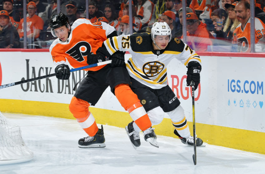 PHILADELPHIA, PA - MARCH 10: Tyler Pitlick #18 of the Philadelphia Flyers and Connor Clifton #75 of the Boston Bruins collide in the third period at Wells Fargo Center on March 10, 2020 in Philadelphia, Pennsylvania. The Bruins won 2-0. (Photo by Drew Hallowell/Getty Images)