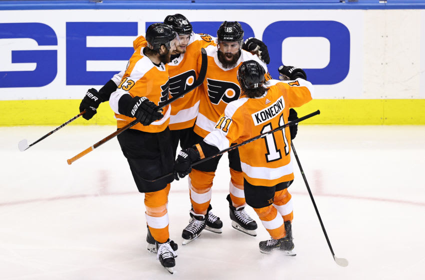 TORONTO, ONTARIO - SEPTEMBER 01: Matt Niskanen #15 of the Philadelphia Flyers is congratulated by his teammates after scoring a goal against the New York Islanders during the third period in Game Five of the Eastern Conference Second Round during the 2020 NHL Stanley Cup Playoffs at Scotiabank Arena on September 01, 2020 in Toronto, Ontario. (Photo by Elsa/Getty Images)