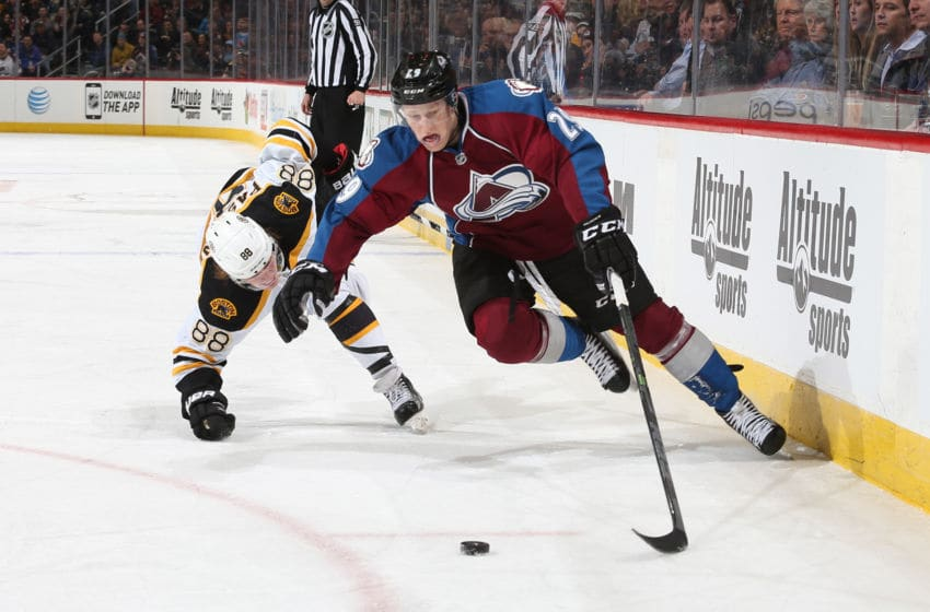 DENVER, CO - JANUARY 21: Nathan MacKinnon #29 of the Colorado Avalanche skates with the puck as he is challenged by David Pastrnak #88 of the Boston Bruins at the Pepsi Center on January 21, 2015 in Denver, Colorado. (Photo by Michael Martin/NHLI via Getty Images)