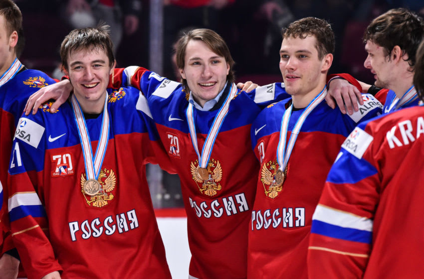 MONTREAL, QC - JANUARY 05: Members of Team Russia celebrate their victory during the 2017 IIHF World Junior Championship bronze medal game against Team Sweden at the Bell Centre on January 5, 2017 in Montreal, Quebec, Canada. Team Russia defeated Team Sweden 2-1 in overtime to win the bronze medal. (Photo by Minas Panagiotakis/Getty Images)