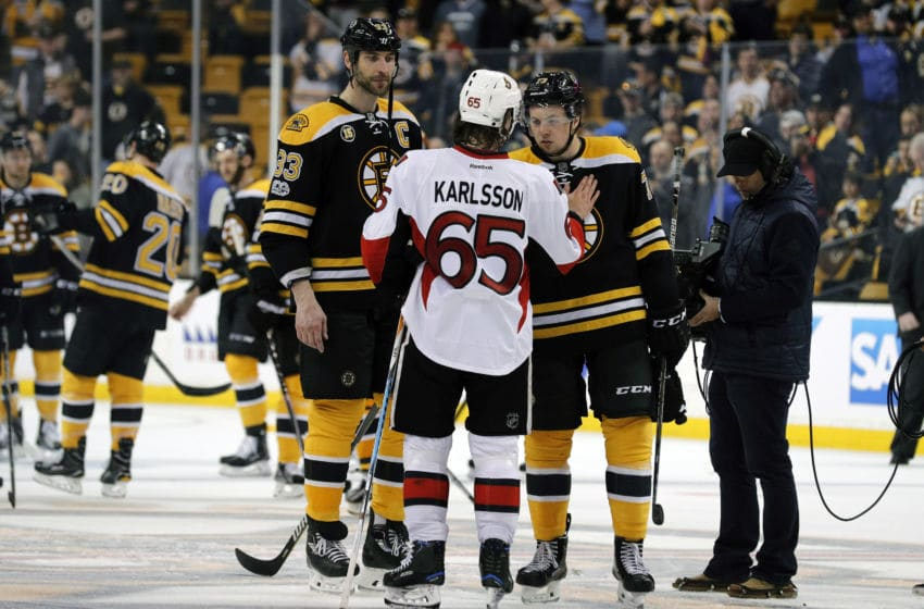 BOSTON, MA - APRIL 23: Ottawa Senators defenseman Erik Karlsson (65) speaks with Boston Bruins right defenseman Charlie McAvoy (73) after Game 6 of a first round NHL playoff series between the Boston Bruins and the Ottawa Senators on April 23, 2017, at TD Garden in Boston, Massachusetts. The Senators defeated the Bruins 3-2 (OT). (Photo by Fred Kfoury III/Icon Sportswire via Getty Images)