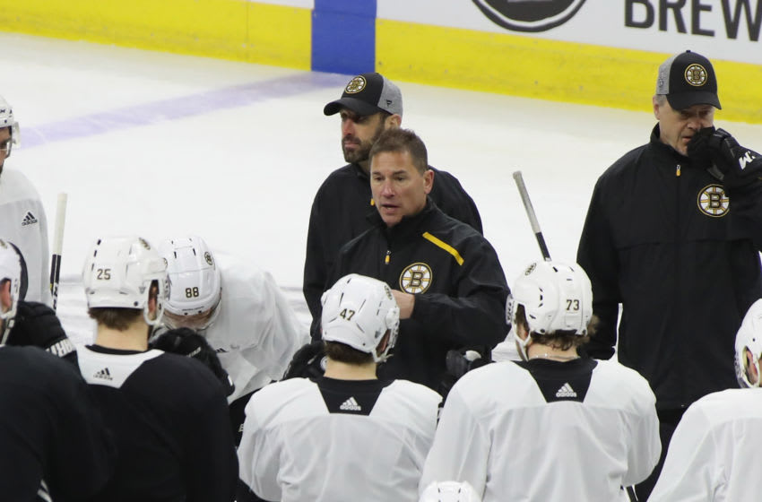 RALEIGH, NORTH CAROLINA - MAY 14: Head coach Bruce Cassidy of the Boston Bruins handles the morning skate prior to Game Three of the Eastern Conference Final during the 2019 NHL Stanley Cup Playoffs at the PNC Bank Arena on May 14, 2019 in Raleigh, North Carolina. (Photo by Bruce Bennett/Getty Images)