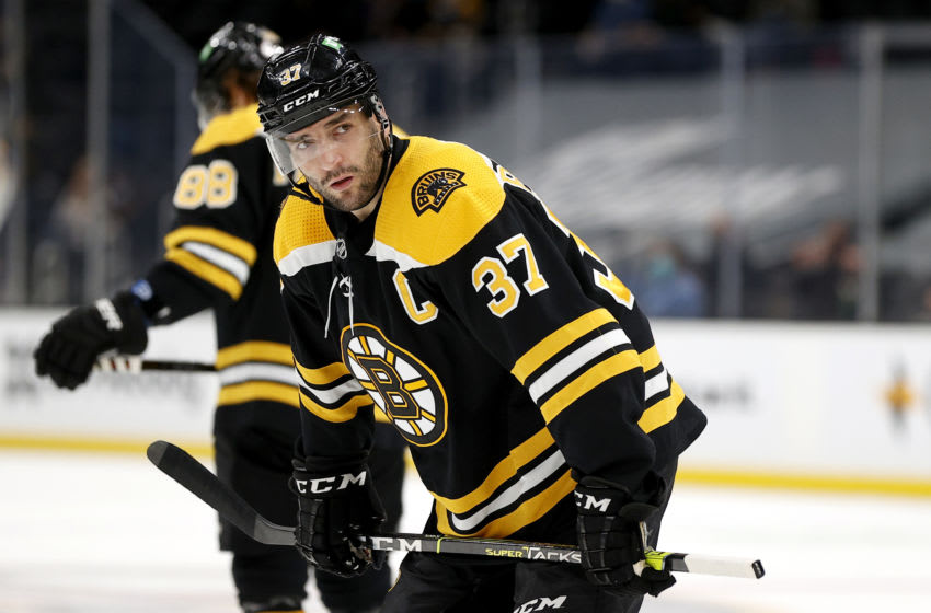 BOSTON, MASSACHUSETTS - MAY 01: Patrice Bergeron #37 of the Boston Bruins looks on during the first period against the Buffalo Sabres at TD Garden on May 01, 2021 in Boston, Massachusetts. (Photo by Maddie Meyer/Getty Images)
