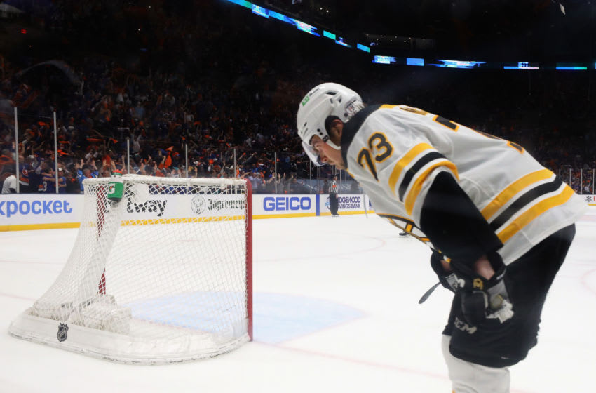 UNIONDALE, NEW YORK - JUNE 09: Charlie McAvoy #73 of the Boston Bruins pauses following a New York Islanders empty net goal during a 6-2 loss in Game Six of the Second Round of the 2021 NHL Stanley Cup Playoffs at the Nassau Coliseum on June 09, 2021 in Uniondale, New York. (Photo by Bruce Bennett/Getty Images)