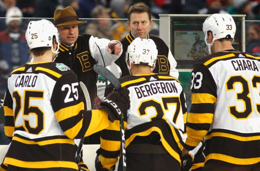 SOUTH BEND, IN - JANUARY 01: Head coach Bruce Cassidy of the Boston Bruins talks to his team while they play against the Chicago Blackhawks in the 2019 Bridgestone NHL Winter Classic game at Notre Dame Stadium on January 1, 2019 in South Bend, Indiana. (Photo by Mark Blinch/NHLI via Getty Images)