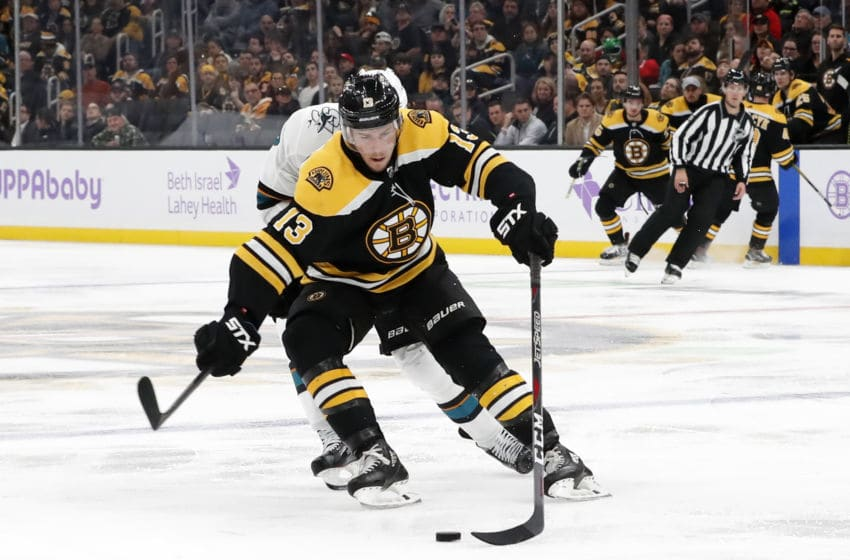 BOSTON, MA - OCTOBER 29: Boston Bruins center Charlie Coyle (13) corrals the puck during a game between the Boston Bruins and the San Jose Sharks on October 29, 2019, at TD Garden in Boston, Massachusetts. (Photo by Fred Kfoury III/Icon Sportswire via Getty Images)