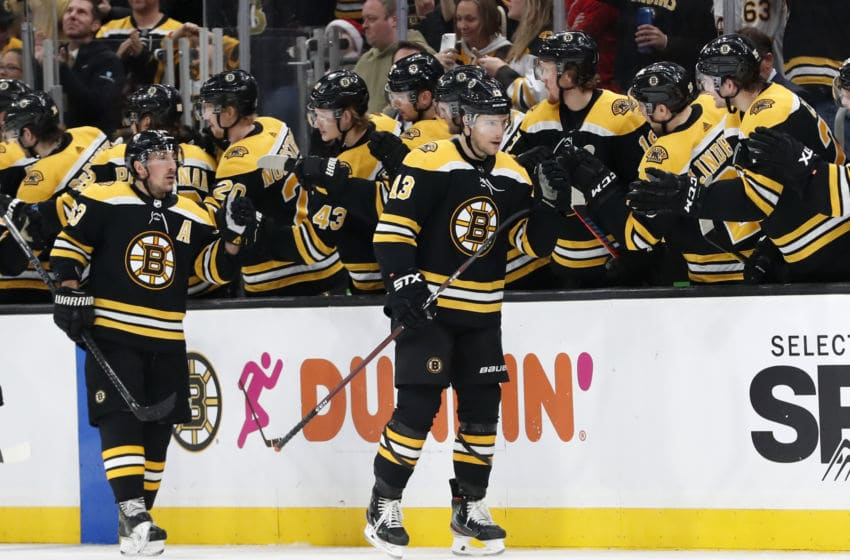 BOSTON, MA - DECEMBER 23: Boston Bruins center Charlie Coyle (13) skates by the bench after scoring his 100th NHL goal shorthanded during a game between the Boston Bruins and the Washington Capitals on December 23, 2019 at TD Garden in Boston, Massachusetts. (Photo by Fred Kfoury III/Icon Sportswire via Getty Images)