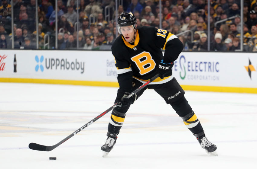 BOSTON, MASSACHUSETTS - FEBRUARY 15: Charlie Coyle #13 of the Boston Bruins skates against the Detroit Red Wings during the first period at TD Garden on February 15, 2020 in Boston, Massachusetts. (Photo by Maddie Meyer/Getty Images)