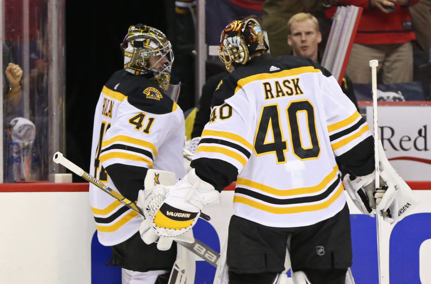Oct 3, 2018; Washington, DC, USA; Boston Bruins goaltender Tuukka Rask (40) encourages Bruins goaltender Jaroslav Halak (41) after being removed from he game against the Washington Capitals in the second period at Capital One Arena. Mandatory Credit: Geoff Burke-USA TODAY Sports
