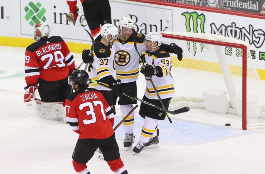 Jan 14, 2021; Newark, New Jersey, USA; The Boston Bruins celebrate a goal by Boston Bruins left wing Nick Ritchie (21) during the third period of their game against the New Jersey Devils at Prudential Center. Mandatory Credit: Ed Mulholland-USA TODAY Sports