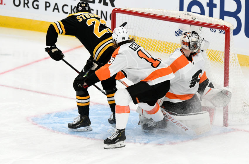 Jan 21, 2021; Boston, Massachusetts, USA; Boston Bruins center Jack Studnicka (23) scores on Philadelphia Flyers goaltender Carter Hart (79) during the third period at the TD Garden. Mandatory Credit: Brian Fluharty-USA TODAY Sports