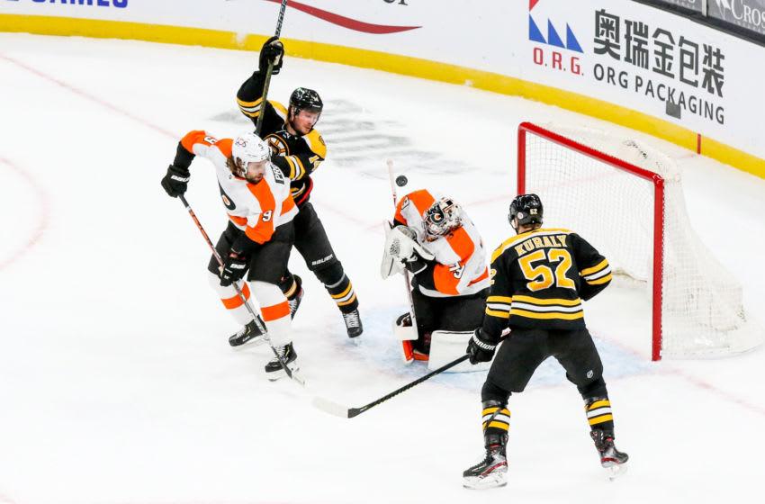 Jan 23, 2021; Boston, Massachusetts, USA; Philadelphia Flyers goalie Carter Hart (79) blocks a shot during the first period against the Boston Bruins at TD Garden. Mandatory Credit: Paul Rutherford-USA TODAY Sports