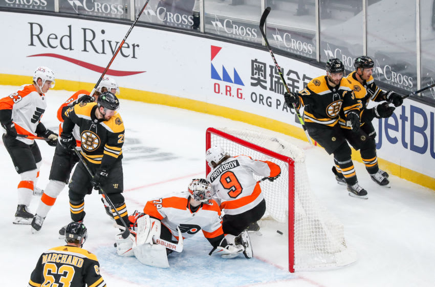 Jan 23, 2021; Boston, Massachusetts, USA; Boston Bruins center Patrice Bergeron (37) celebrates after scoring during the third period against the Philadelphia Flyers at TD Garden. Mandatory Credit: Paul Rutherford-USA TODAY Sports