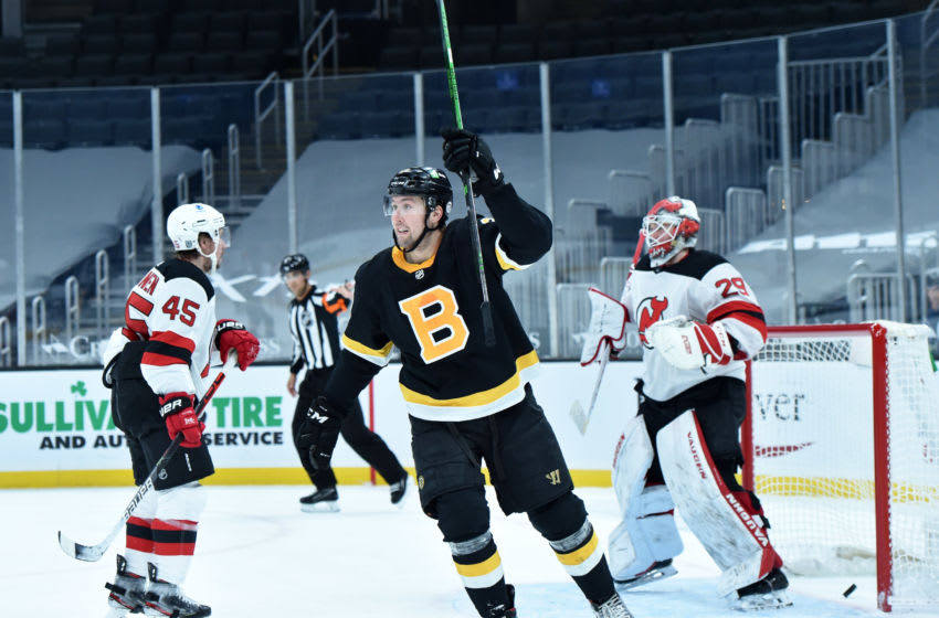 Feb 18, 2021; Boston, Massachusetts, USA; Boston Bruins left wing Nick Ritchie (21) reacts on a goal past New Jersey Devils goaltender Mackenzie Blackwood (29) by defenseman Charlie McAvoy (73) (not pictured) during the third period at TD Garden. Mandatory Credit: Bob DeChiara-USA TODAY Sports