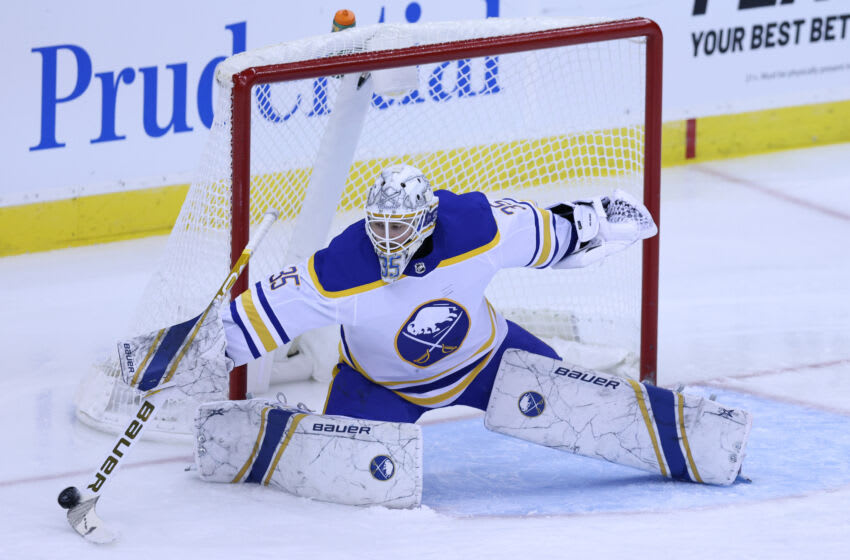 Feb 20, 2021; Newark, New Jersey, USA; Buffalo Sabres goaltender Linus Ullmark (35) sticks the puck aside against the New Jersey Devils during the third period at Prudential Center. Mandatory Credit: Vincent Carchietta-USA TODAY Sports