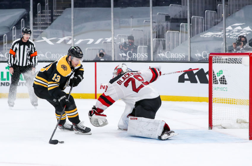 Mar 30, 2021; Boston, Massachusetts, USA; Boston Bruins center Charlie Coyle (13) scores a goal against New Jersey Devils goalie MacKenzie Blackwood (29) during a shootout at TD Garden. Mandatory Credit: Paul Rutherford-USA TODAY Sports
