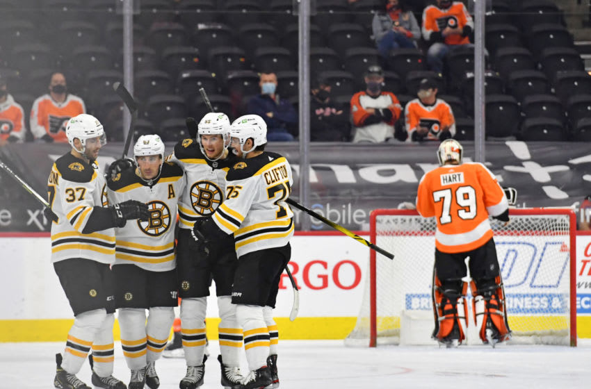Apr 6, 2021; Philadelphia, Pennsylvania, USA; Boston Bruins center Brad Marchand (63) celebrates his shorthanded goal with teammates against the Philadelphia Flyers during the third period at Wells Fargo Center. Mandatory Credit: Eric Hartline-USA TODAY Sports