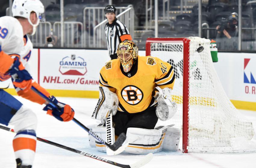 Apr 15, 2021; Boston, Massachusetts, USA; Boston Bruins goaltender Tuukka Rask (40) deflects the puck in the corner during the first period against the New York Islanders at TD Garden. Mandatory Credit: Bob DeChiara-USA TODAY Sports