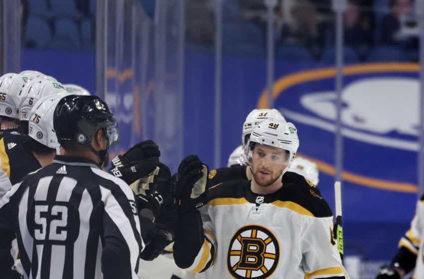 Apr 22, 2021; Buffalo, New York, USA; Boston Bruins defenseman Matt Grzelcyk (48) celebrates his goal with teammates on the bench during the second period against the Buffalo Sabres at KeyBank Center. Mandatory Credit: Timothy T. Ludwig-USA TODAY Sports