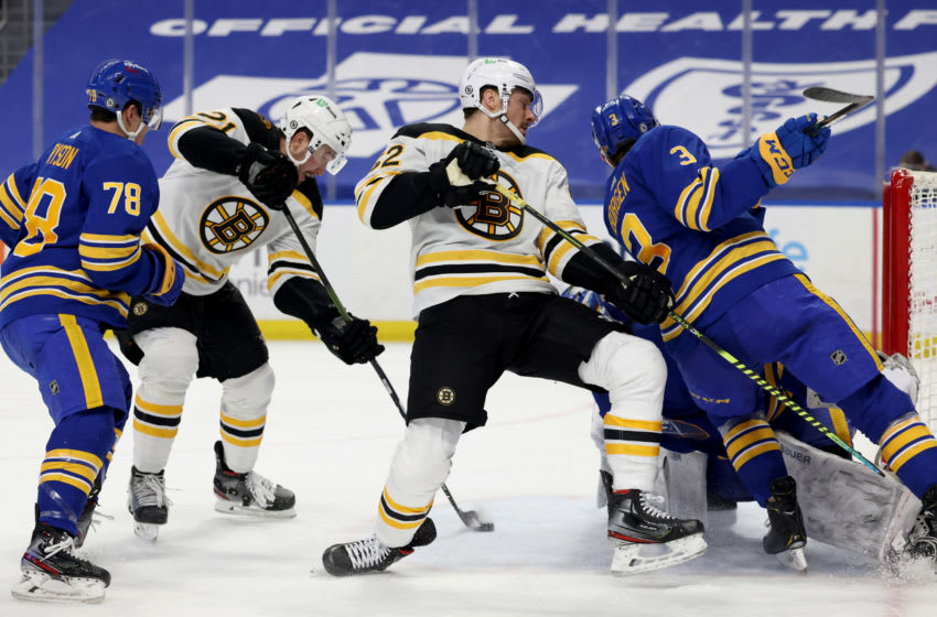 Apr 23, 2021; Buffalo, New York, USA; Boston Bruins left wing Nick Ritchie (21) gets the loose puck and scores a goal during the third period against the Buffalo Sabres at KeyBank Center. Mandatory Credit: Timothy T. Ludwig-USA TODAY Sports