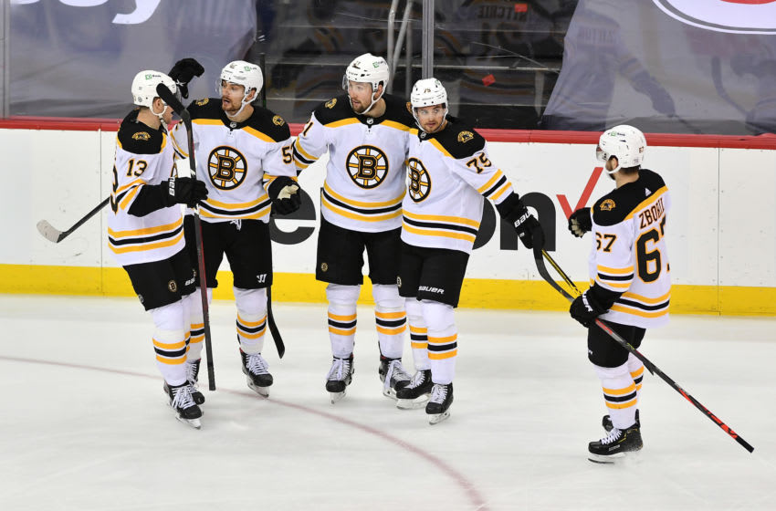 May 3, 2021; Newark, New Jersey, USA; Boston Bruins left wing Nick Ritchie (21) celebrates with teammates after scoring a goal against the New Jersey Devils during the second period at Prudential Center. Mandatory Credit: Catalina Fragoso-USA TODAY Sports