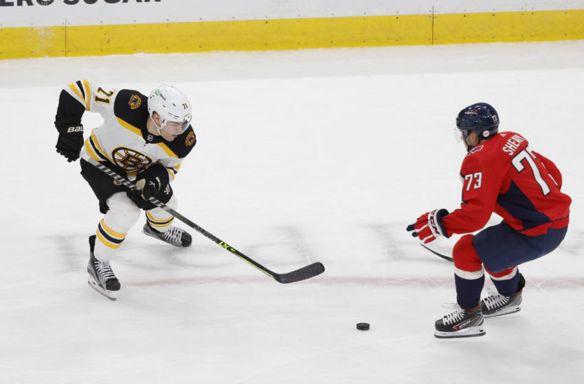 May 15, 2021; Washington, District of Columbia, USA; Boston Bruins left wing Taylor Hall (71) skates with the puck past Washington Capitals left wing Conor Sheary (73) in the third period in game one of the first round of the 2021 Stanley Cup Playoffs at Capital One Arena. Mandatory Credit: Geoff Burke-USA TODAY Sports