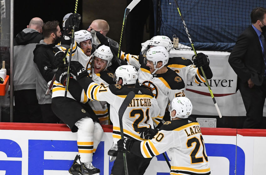 May 17, 2021; Washington, District of Columbia, USA; Boston Bruins center Brad Marchand (left) reacts after scoring the winning goal against the Washington Capitals during the first overtime period in game two of the first round of the 2021 Stanley Cup Playoffs at Capital One Arena. Mandatory Credit: Brad Mills-USA TODAY Sports