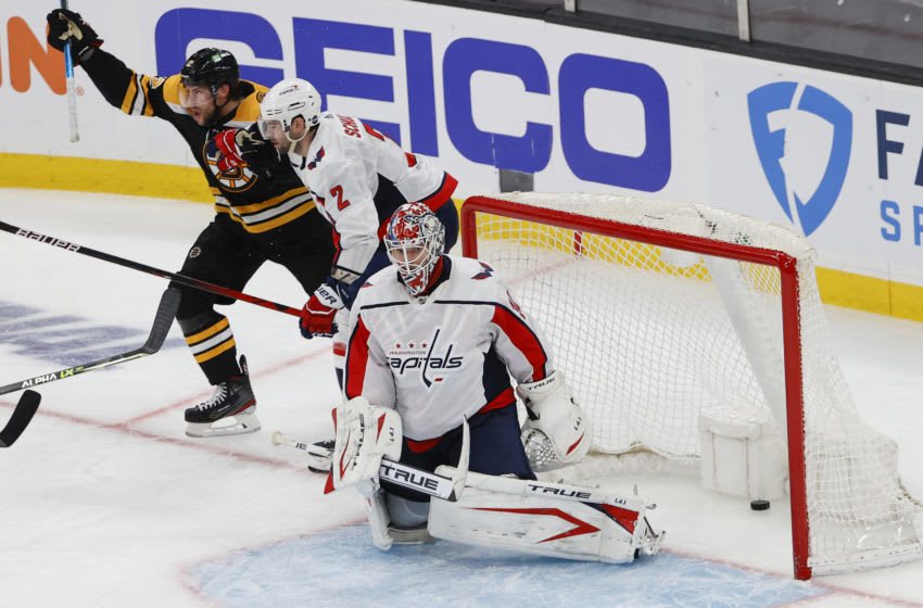 May 19, 2021; Boston, Massachusetts, USA; After stealing the puck from Washington Capitals defenseman Justin Schultz (2), Boston Bruins right wing Craig Smith (12) celebrates his winning goal on goaltender Ilya Samsonov (30) during the second overtime in game three of the first round of the 2021 Stanley Cup Playoffs at TD Garden. Mandatory Credit: Winslow Townson-USA TODAY Sports