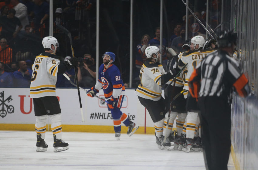 Jun 3, 2021; Uniondale, New York, USA; Boston Bruins players celebrate after defeating the New York Islanders in overtime of game three of the second round of the 2021 Stanley Cup Playoffs at Nassau Veterans Memorial Coliseum. Mandatory Credit: Brad Penner-USA TODAY Sports