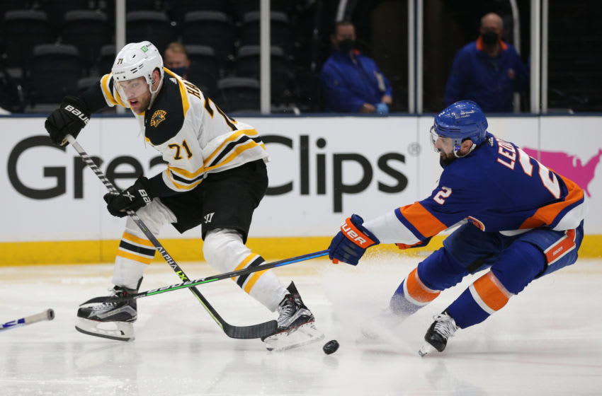 Jun 3, 2021; Uniondale, New York, USA; Boston Bruins left wing Taylor Hall (71) plays the puck against New York Islanders defenseman Nick Leddy (2) during the third period of game three of the second round of the 2021 Stanley Cup Playoffs at Nassau Veterans Memorial Coliseum. Mandatory Credit: Brad Penner-USA TODAY Sports