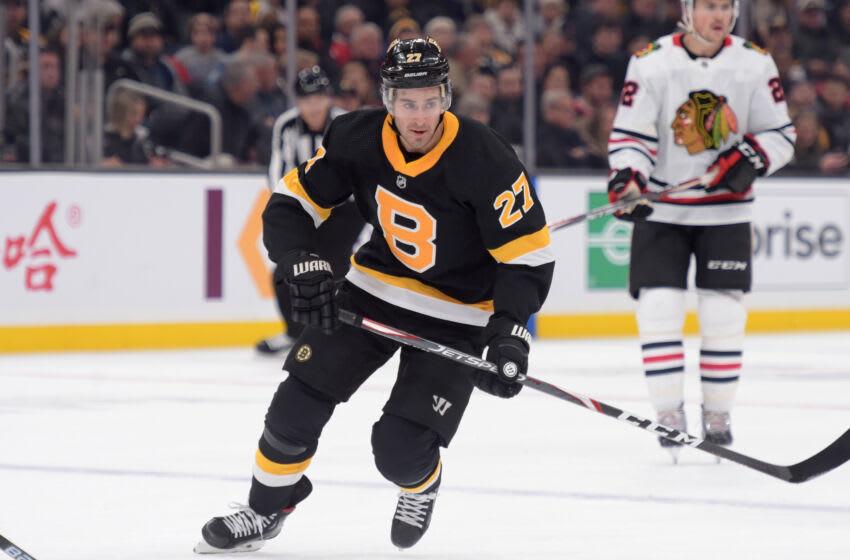 Dec 5, 2019; Boston, MA, USA; Boston Bruins defenseman John Moore (27) skates in the offensive zone against the Chicago Blackhawks during the first period at TD Garden. Mandatory Credit: Bob DeChiara-USA TODAY Sports
