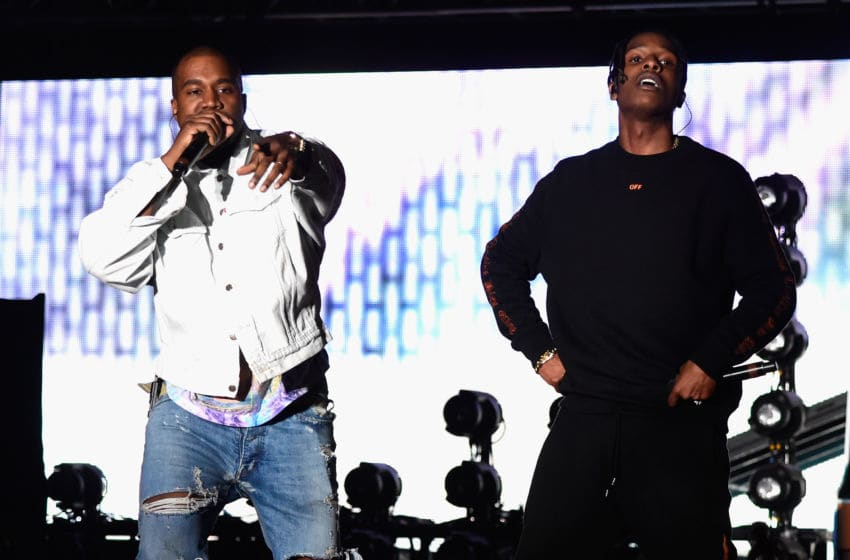 INDIO, CA - APRIL 15: Rappers Kanye West (L) and A$AP Rocky perform onstage during day 1 of the 2016 Coachella Valley Music
