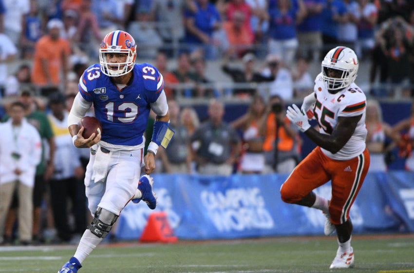ORLANDO, FL - AUGUST 24: Feleipe Franks #13 of the Florida Gators runs for a first down in the first half against the Miami Hurricanes in the Camping World Kickoff at Camping World Stadium on August 24, 2019 in Orlando, Florida.(Photo by Mark Brown/Getty Images)