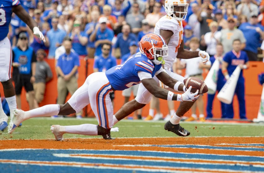 GAINESVILLE, FL- SEPTEMBER 21: Trey Dean III #21 of the Florida Gators intercepts a throw from Jarrett Guarantano #2 of the Tennessee Volunteers during the first half of the game at Ben Hill Griffin Stadium on September 21, 2019 in Gainesville, Florida. (Photo by Carmen Mandato/Getty Images)