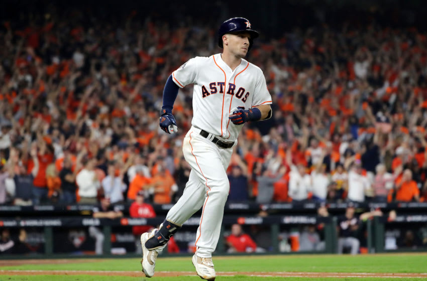 HOUSTON, TEXAS - OCTOBER 23: Alex Bregman #2 of the Houston Astros hits a two-run home run against the Washington Nationals during the first inning in Game Two of the 2019 World Series at Minute Maid Park on October 23, 2019 in Houston, Texas. (Photo by Elsa/Getty Images)