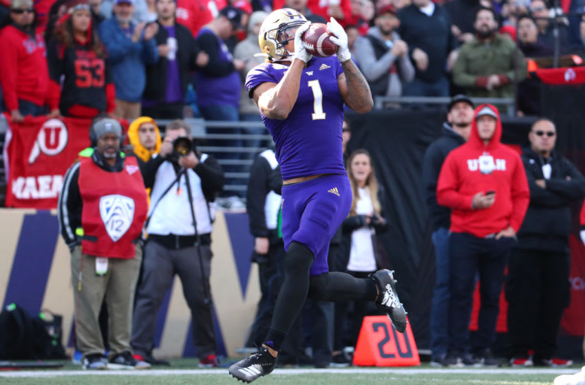 SEATTLE, WASHINGTON - NOVEMBER 02: Hunter Bryant #1 of the Washington Huskies completes a 34 yard touchdown pass against the Utah Utes in the second quarter during their game at Husky Stadium on November 02, 2019 in Seattle, Washington. (Photo by Abbie Parr/Getty Images)