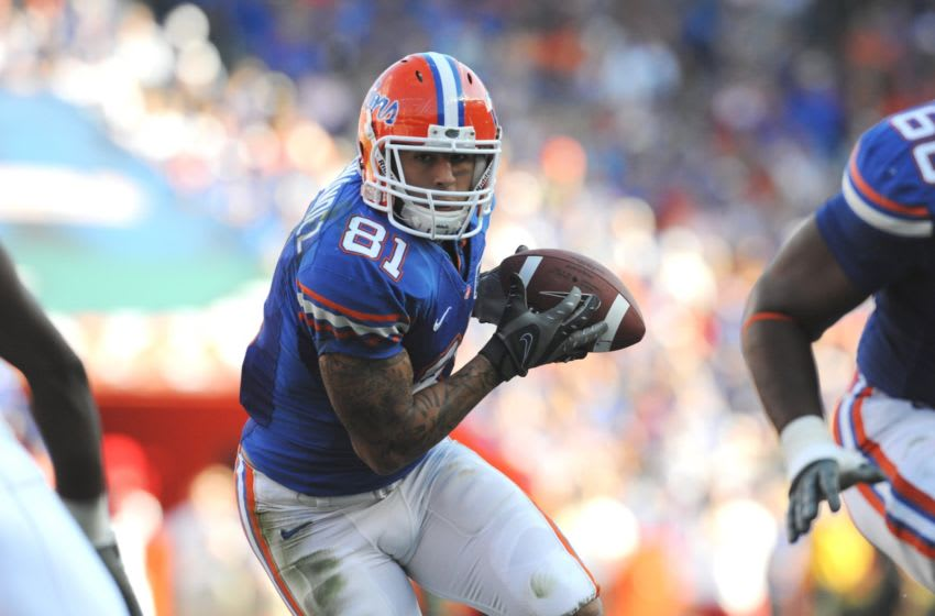 GAINESVILLE, FL - OCTOBER 17: Tight end Aaron Hernandez #81 of the Florida Gators rushes upfield with a pass against the University of Arkansas Razorbacks October 17, 2009 at Ben Hill Griffin Stadium in Gainesville, Florida. (Photo by Al Messerschmidt/Getty Images)