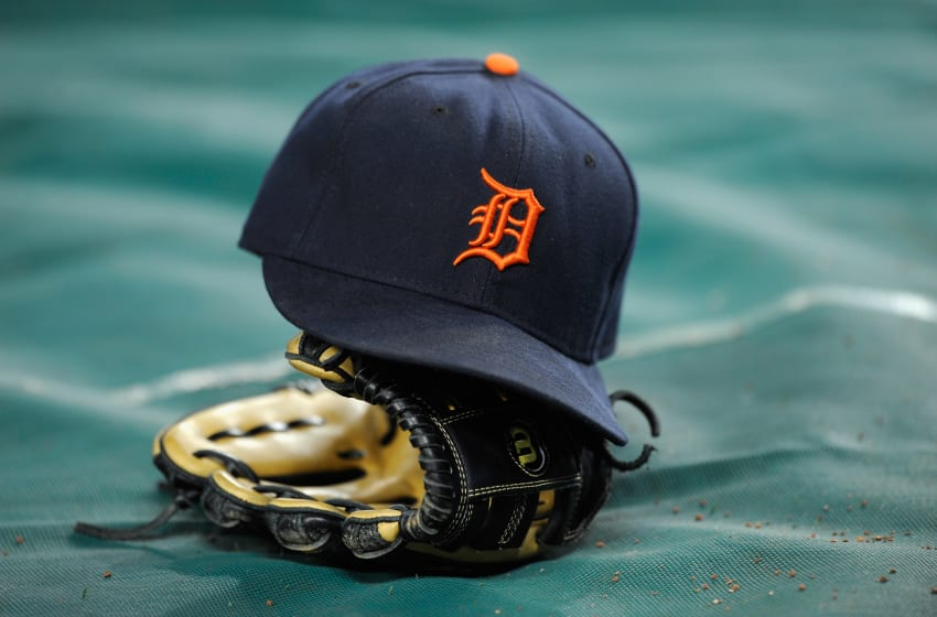 NEW YORK, NY - OCTOBER 06: A detail of a Detroit Tigers hat and glove are seen during warm ups against the New York Yankees during Game Five of the American League Championship Series at Yankee Stadium on October 6, 2011 in the Bronx borough of New York City. (Photo by Patrick McDermott/Getty Images)