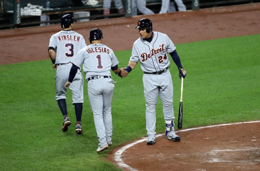 BALTIMORE, MD - AUGUST 03: Miguel Cabrera #24 of the Detroit Tigers celebrates with Ian Kinsler #3 and Jose Iglesias #1 after they both scored against the Baltimore Orioles in the third inning at Oriole Park at Camden Yards on August 3, 2017 in Baltimore, Maryland. (Photo by Rob Carr/Getty Images)